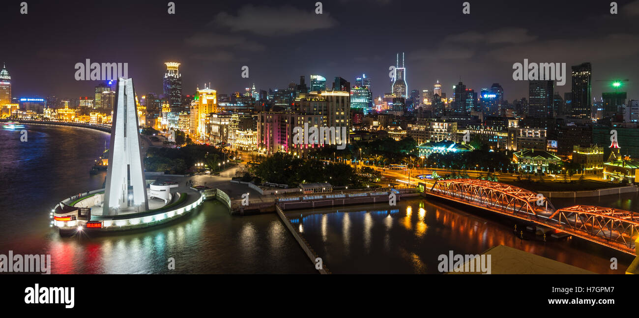 Aerial panorama at night of the Bund with Waibaidu bridge and Monument to the People's Heroes, Shanghai, China Stock Photo