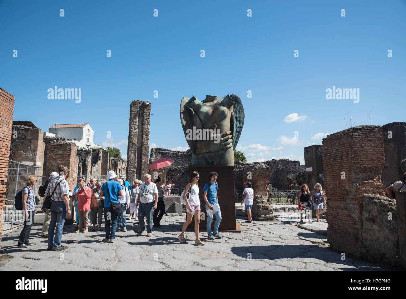 Tourists on the  ancient Pompeii streets,  archaeological site, Campania region, Italy - Stock Image