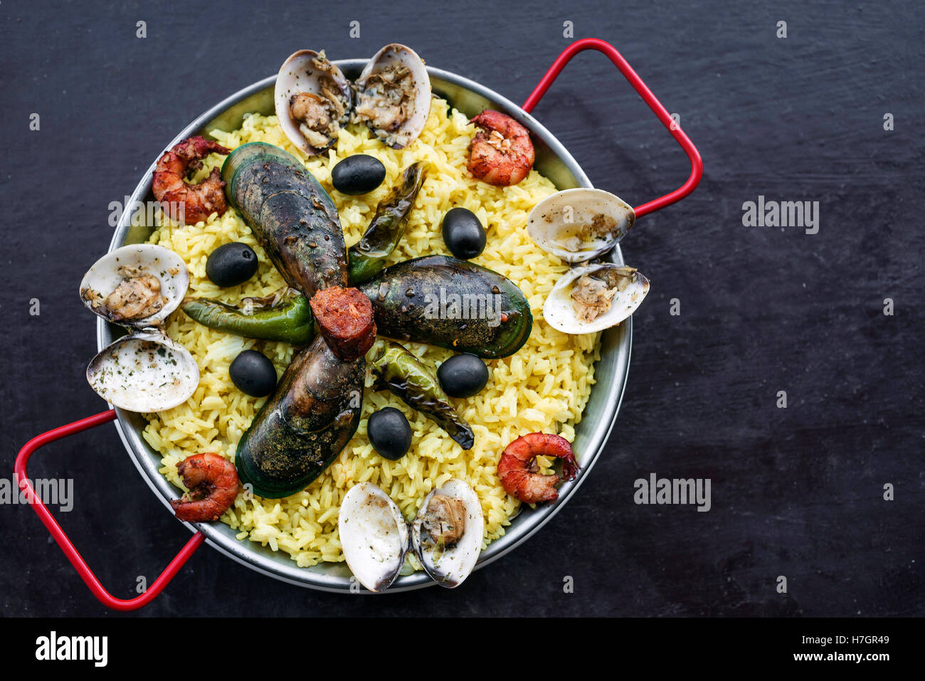 mixed fresh steamed seafood and rice paella famous traditional portuguese spanish meal - Stock Image