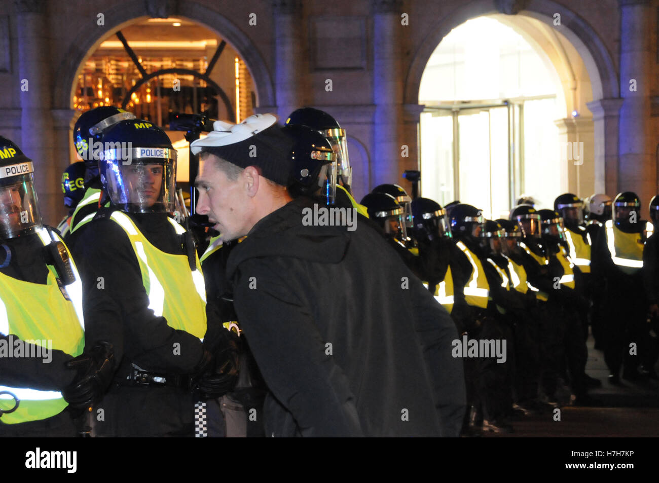 London, UK, 5th November, 2016. A protester makes an attempt to provoke the police, at last night's Million Mask Stock Photo