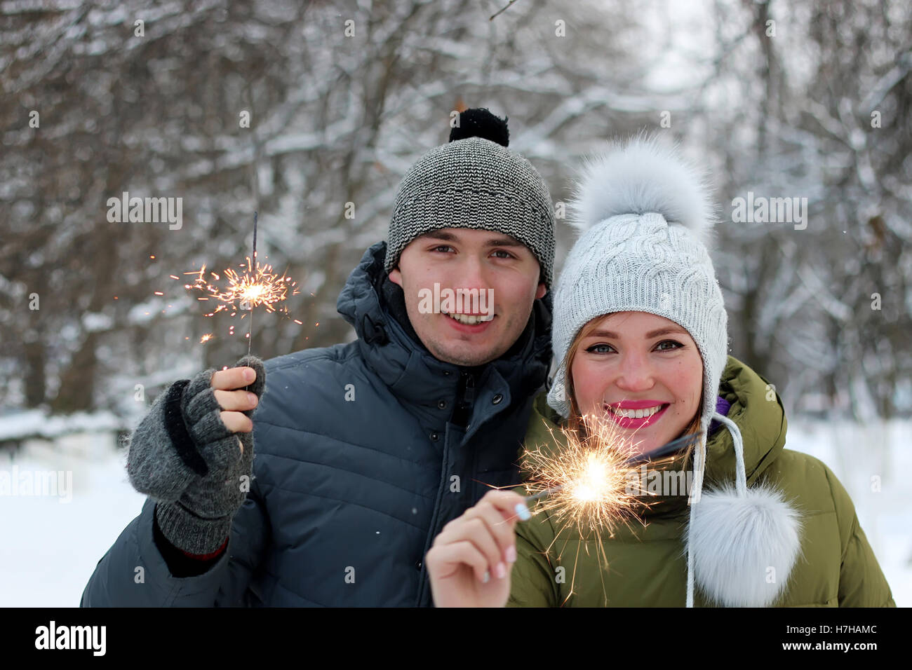 couple with sparklers on the street - Stock Image