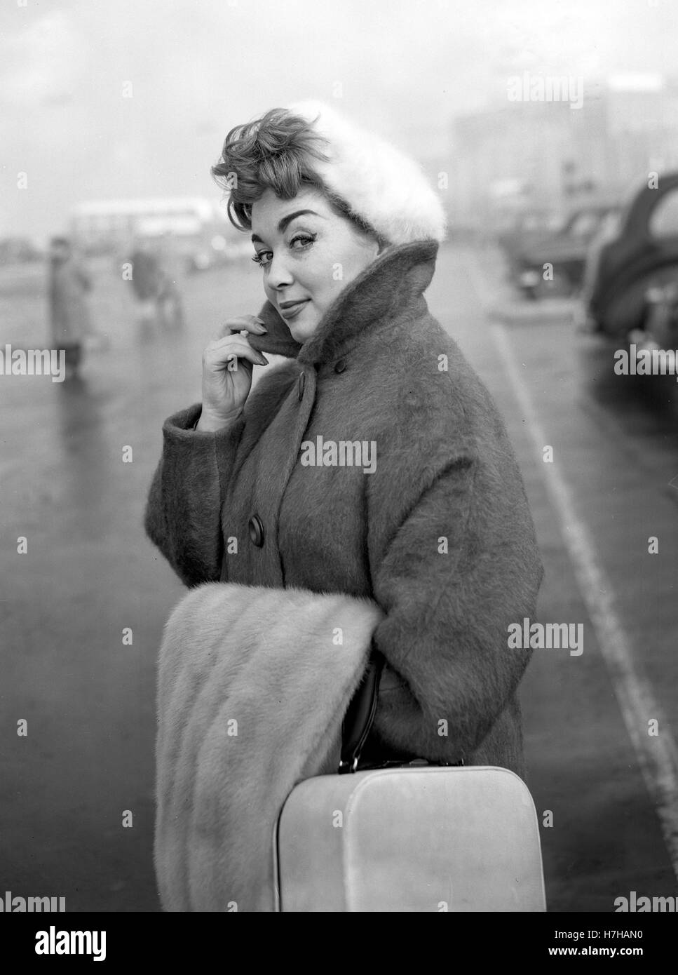 Singer Marion Ryan at London Airport, where she was off to Germany to entertain British Forces. - Stock Image