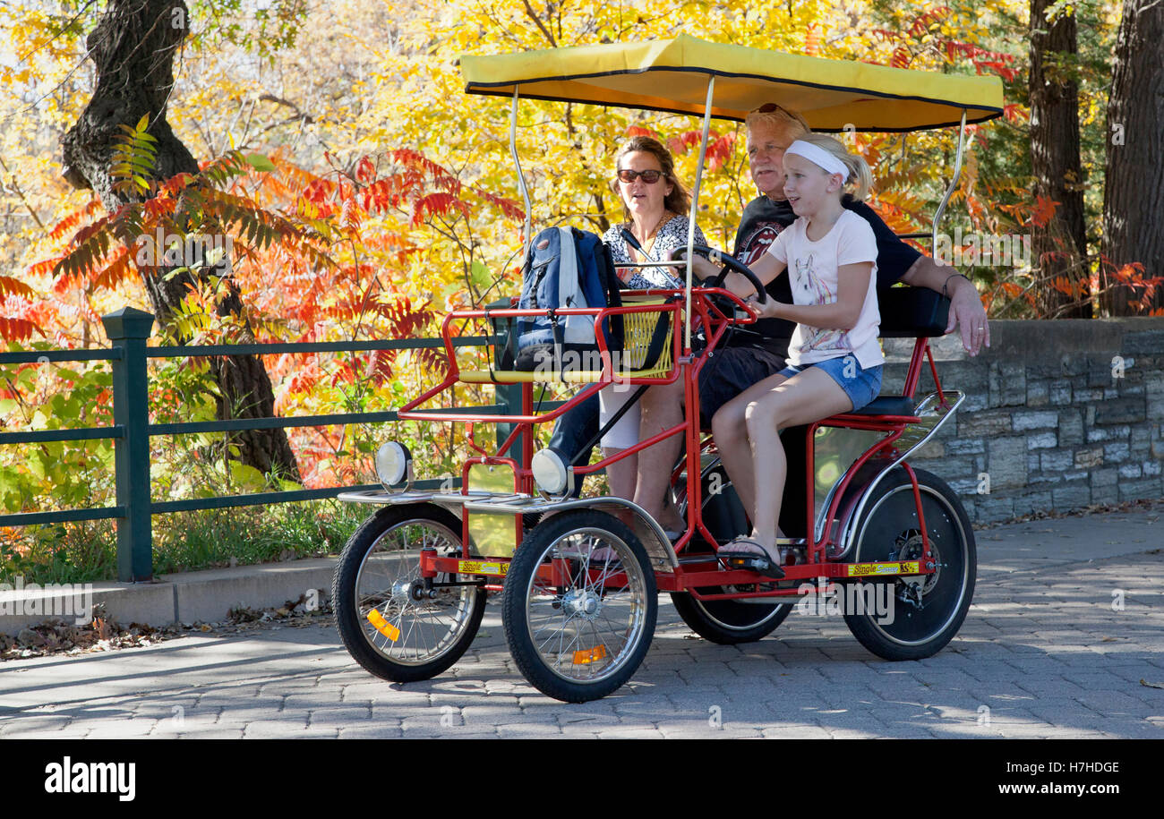 Young girl peddling her family on a Double Surrey Bike in
