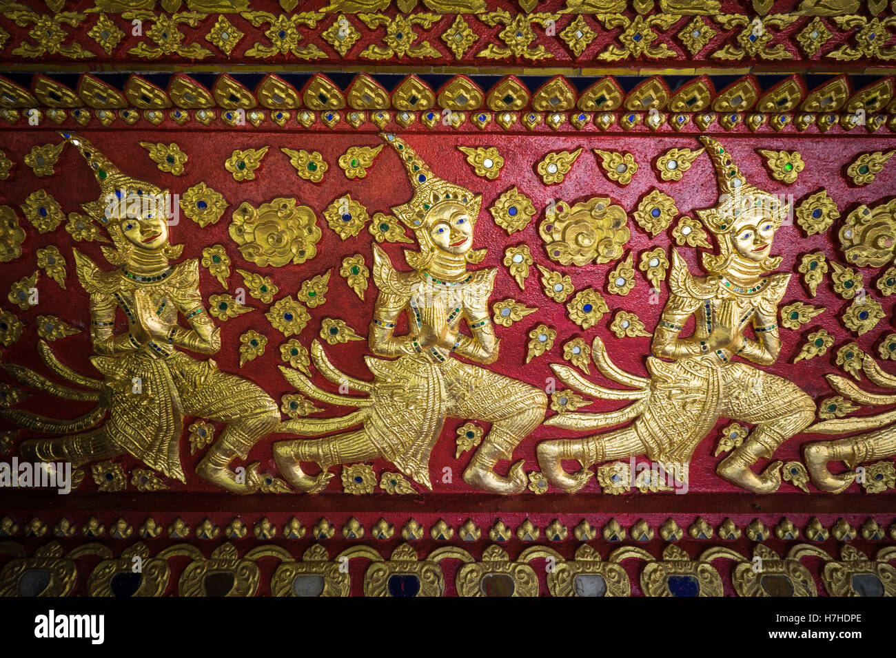 Detailed painted artwork in the buddhist temple, Wat Suan Dok in Chiang Mai, northern Thailand. - Stock Image