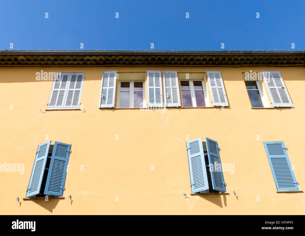 Shuttered windows on a building in Sainte Maxime, Var, France. - Stock Image