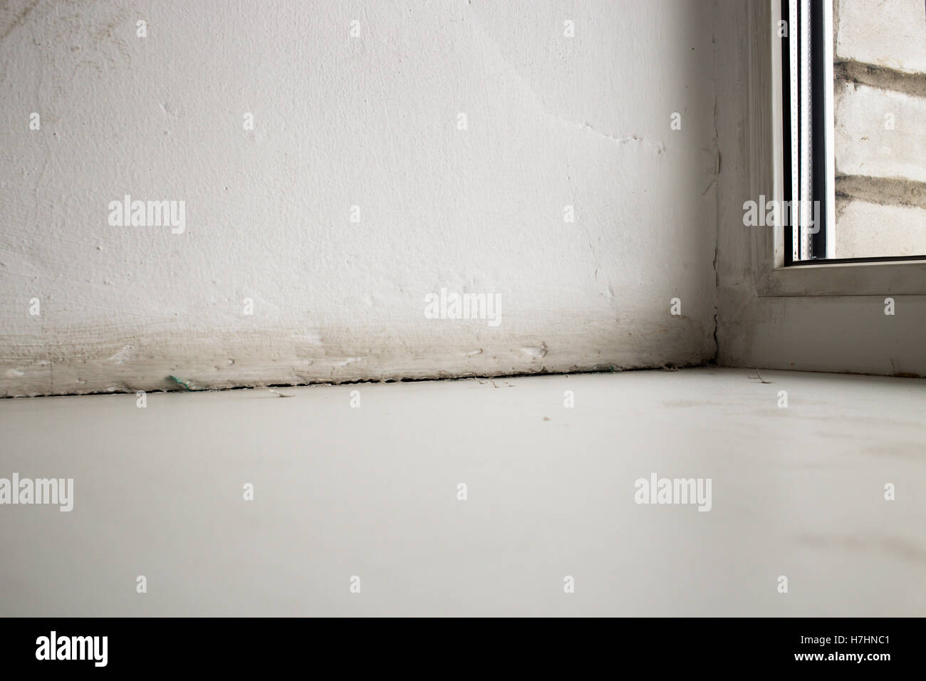 The crack between the sill window and the wall due to the deformation (shrinkage) of the house - Stock Image