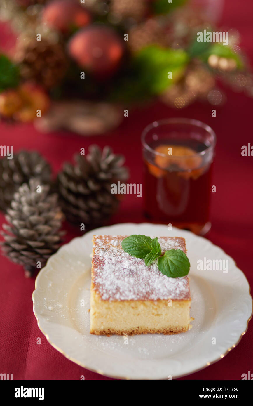 Cheesecake decorated with a leaf of mint - Stock Image