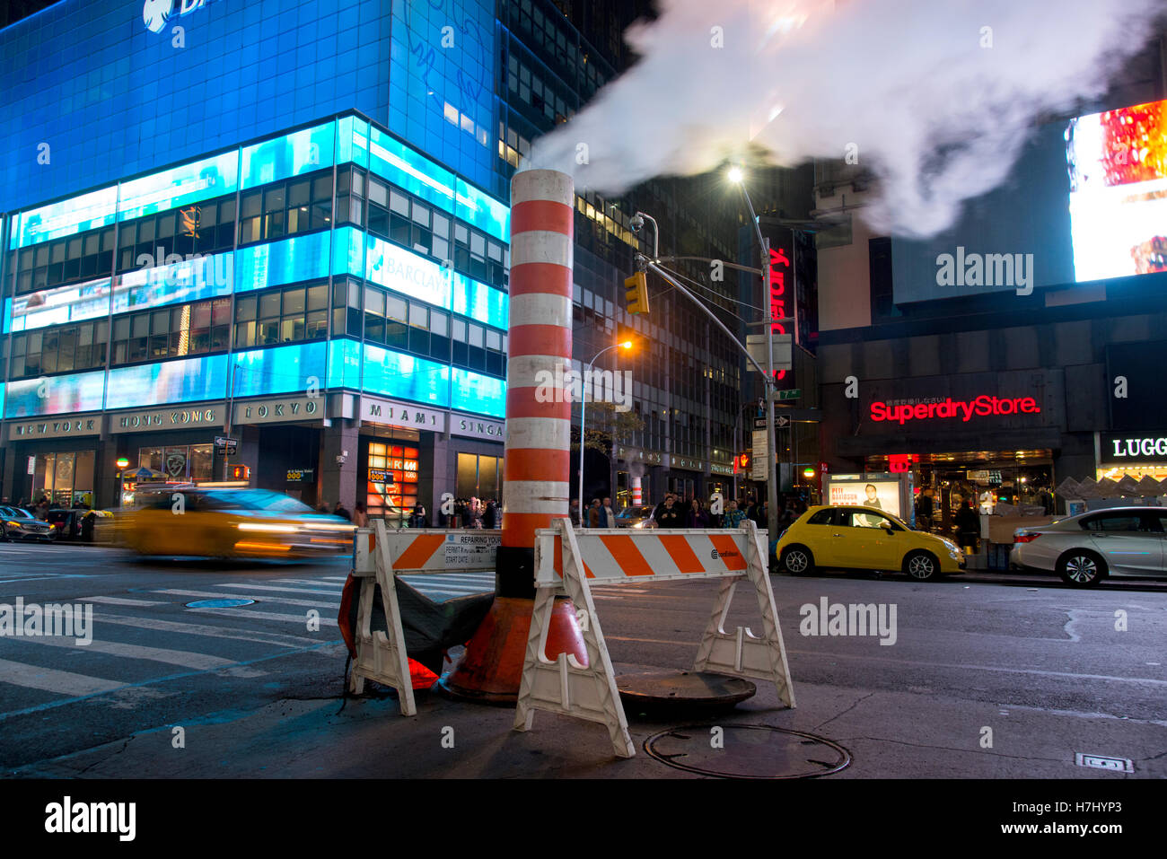 Con-Edison steam system stack venting vapour into the night on 7th Avenue, Manhattan, New York - Stock Image