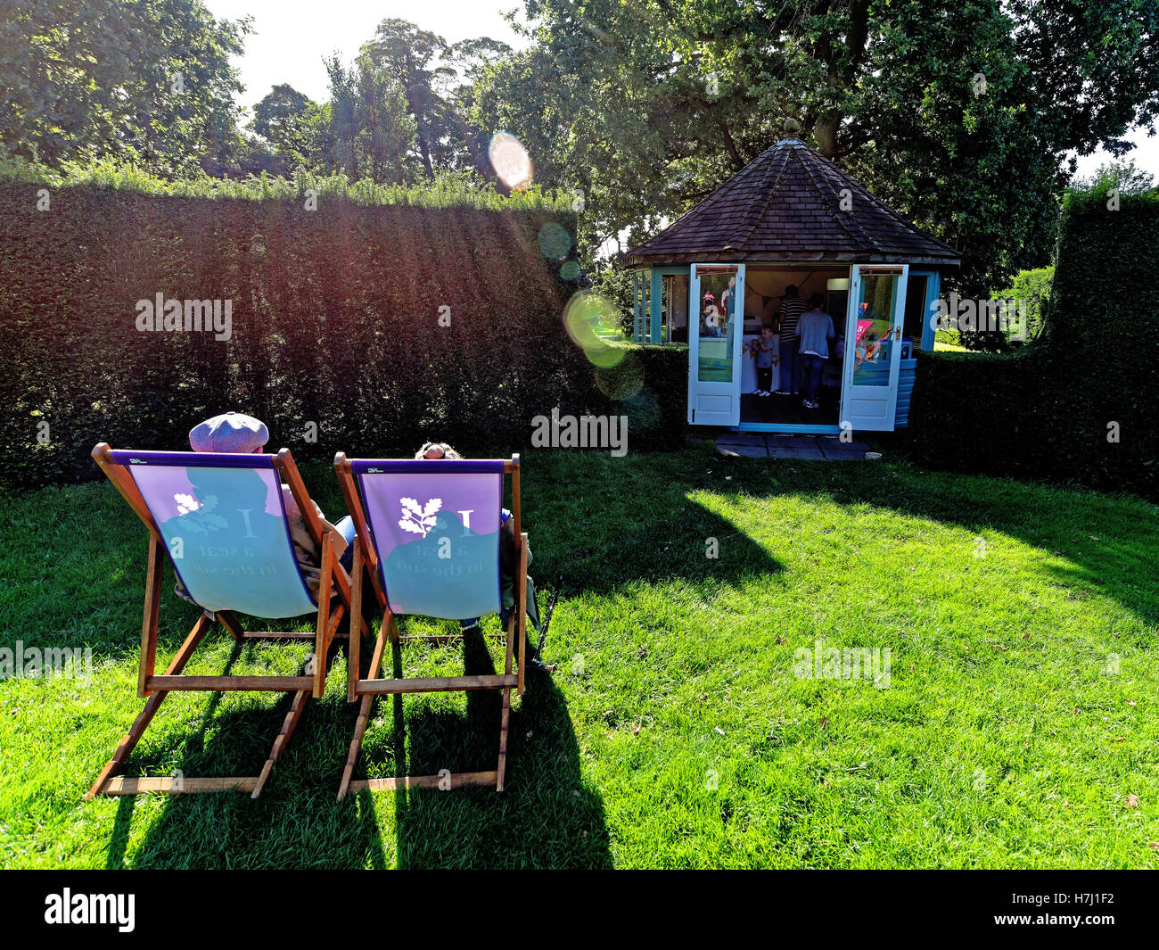 A seat in the evening sun - Stock Image