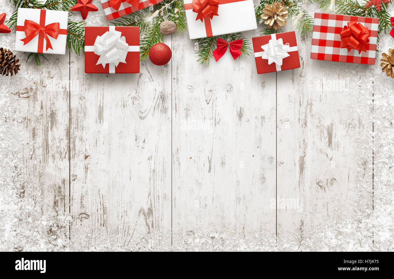 Christmas gifts on white wooden table with free space for text. Top ...