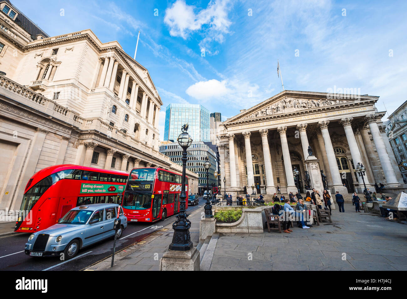 LONDON - NOVEMBER 3, 2016: Modern red double-decker bus passes in front of the Bank of England and Royal Exchange - Stock Image