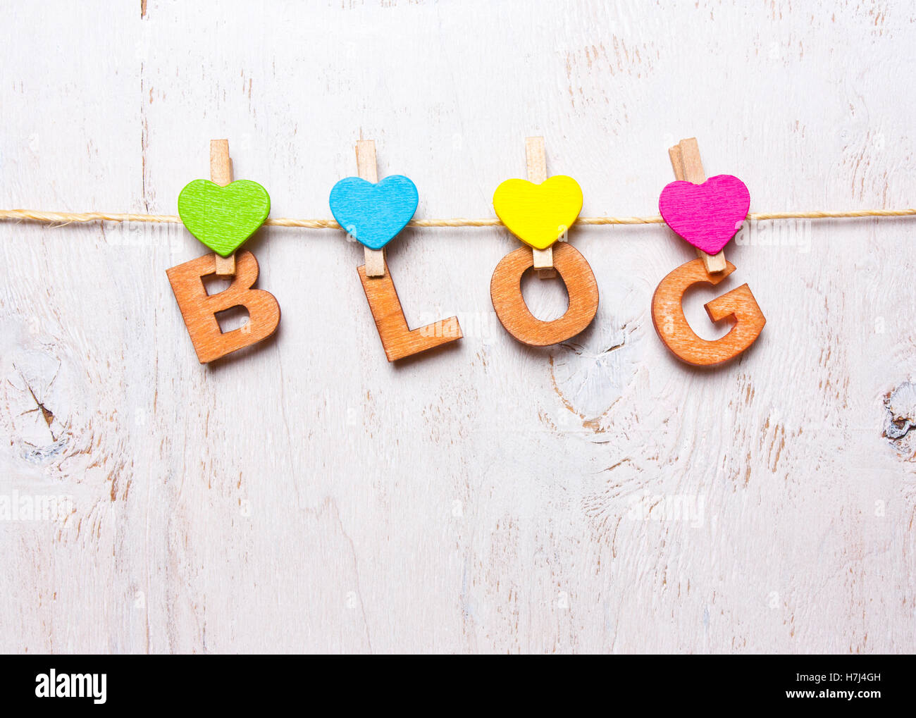 the word 'blog' of wooden letters on a white background - Stock Image