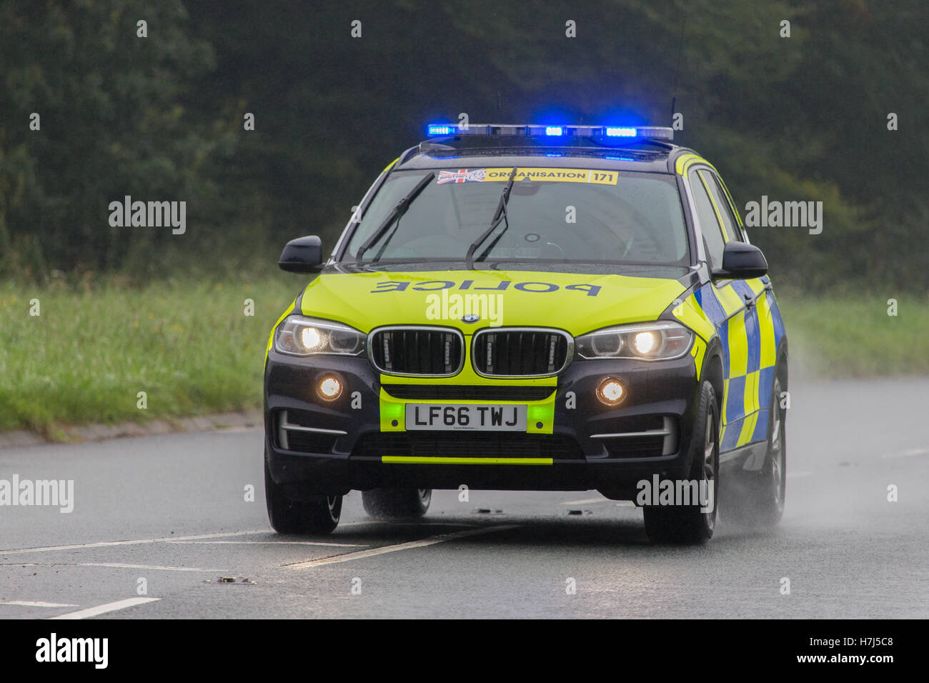 A Police Traffic car clearing the road for the Tour of Britain Cycle Race, about to enter Kendal Stock Photo