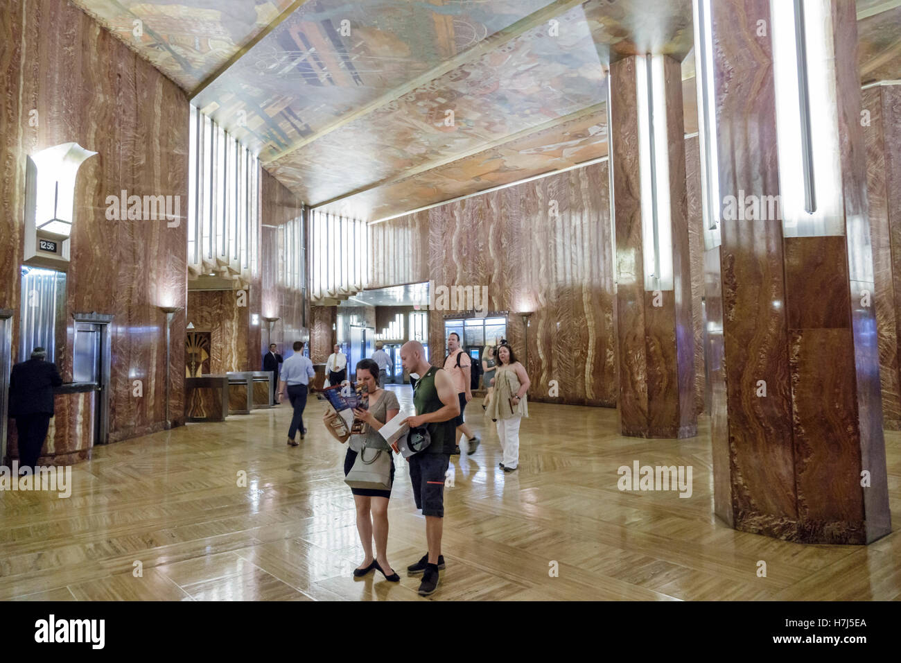 Manhattan New York City NYC NY Midtown 42nd Street Chrysler Building lobby marble Art Deco man woman couple ceiling - Stock Image