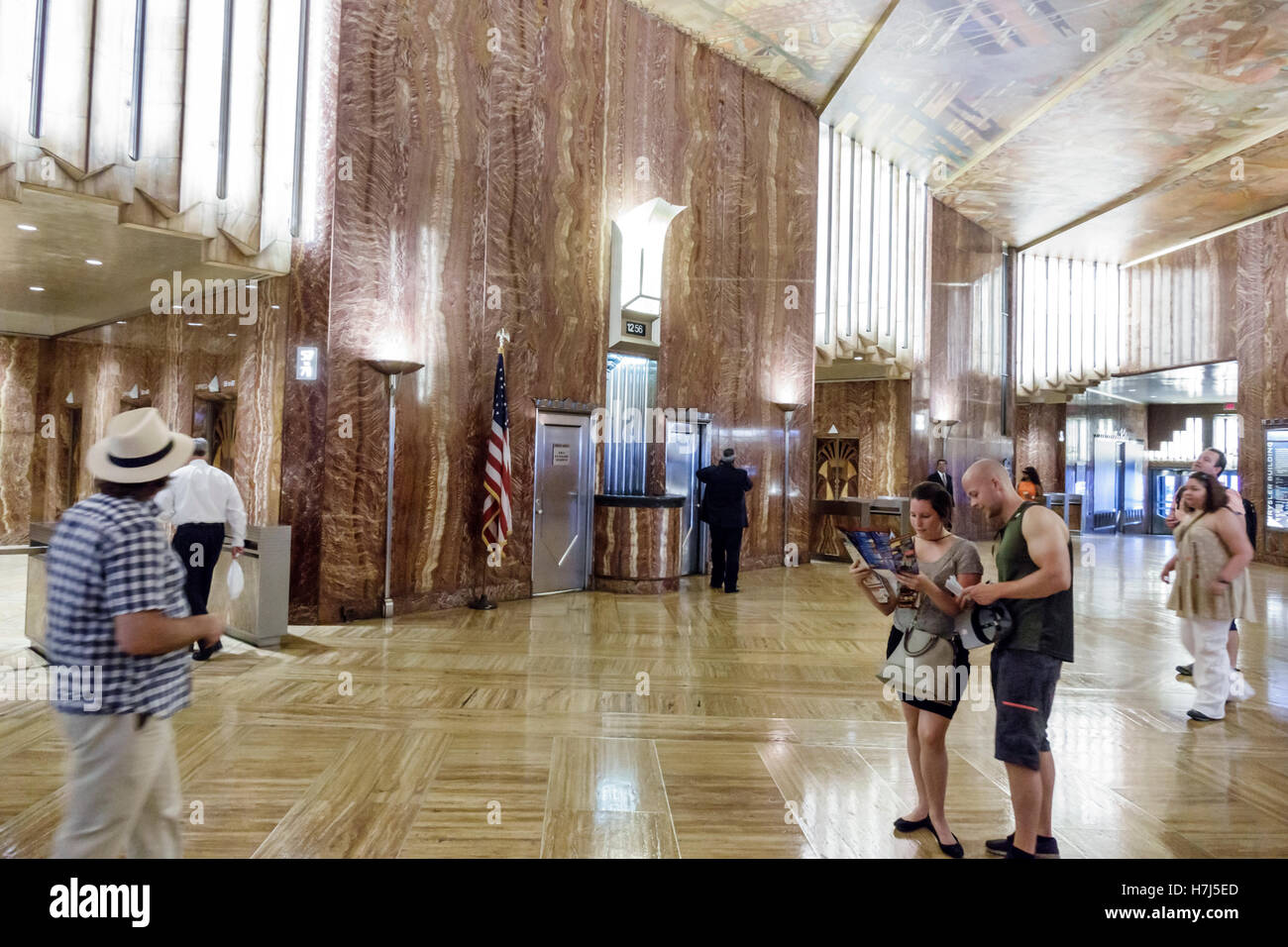 Manhattan New York City NYC NY Midtown 42nd Street Chrysler Building lobby marble Art Deco man woman couple ceiling - Stock Image