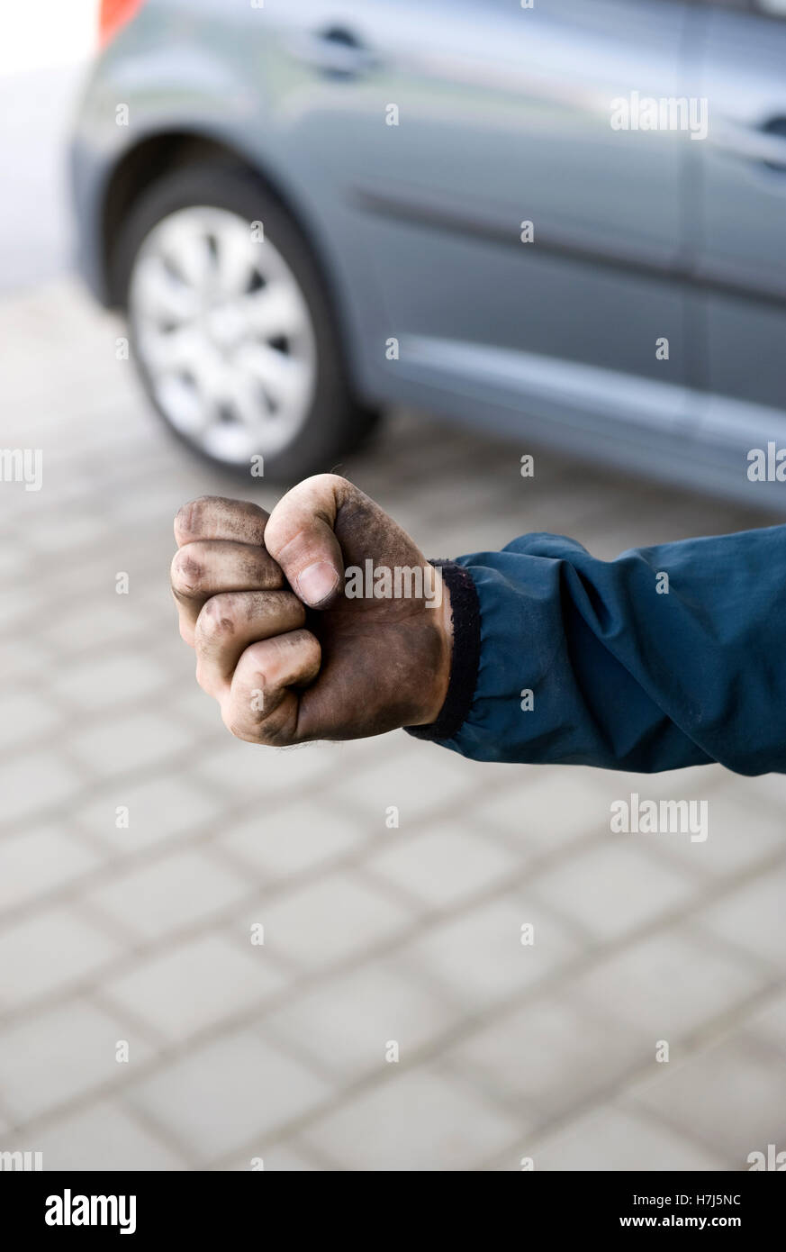 Manual labourer with a clenched fist - Stock Image