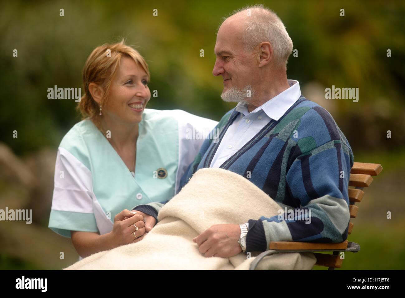 Old man with nurse - Stock Image
