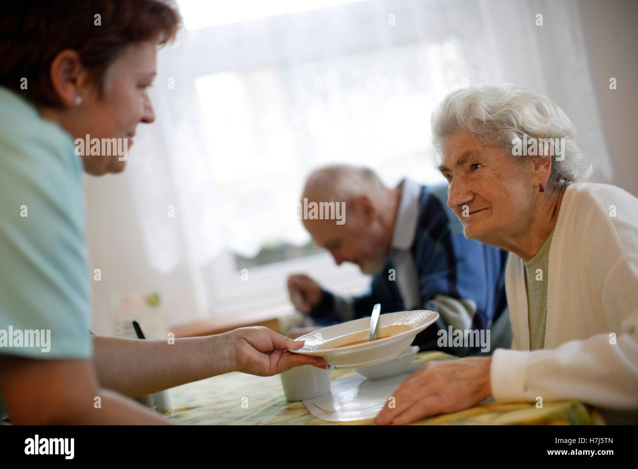 Old woman with nurse - Stock Image