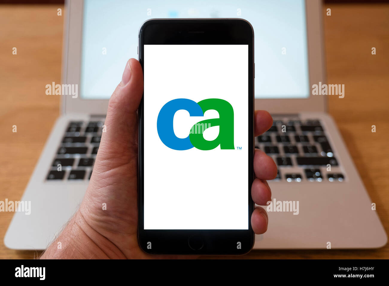 Using iPhone smart phone to display logo of CA Technologies , information technology company Stock Photo