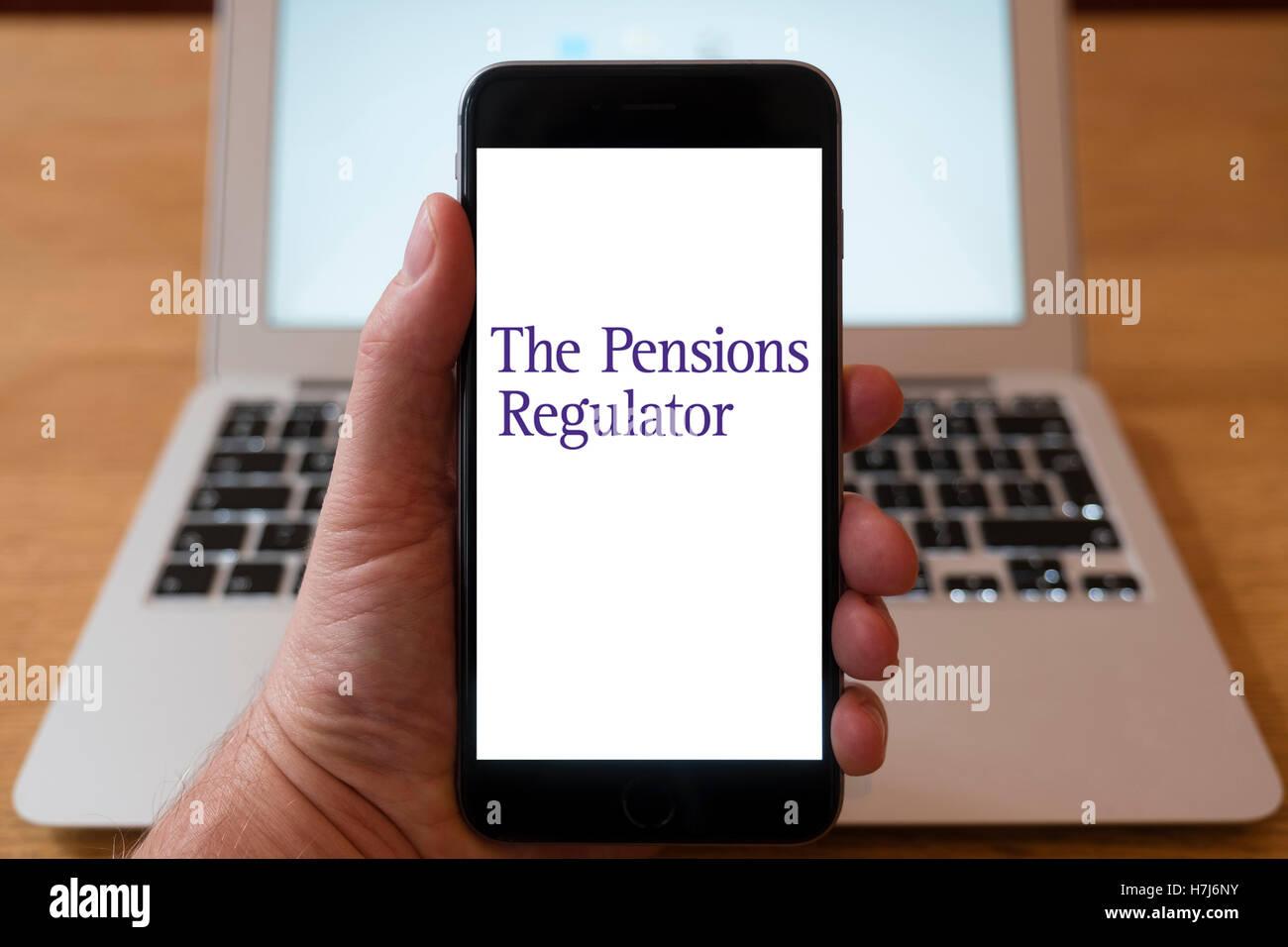 Using iPhone smart phone to display logo of The Pensions Regulator - Stock Image