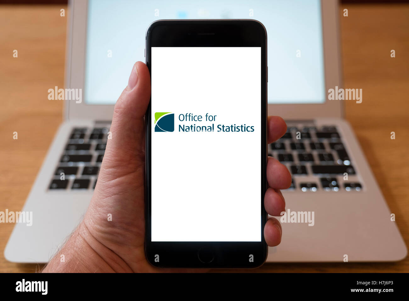 Using iPhone smart phone to display logo of the Office for National Statistics - Stock Image