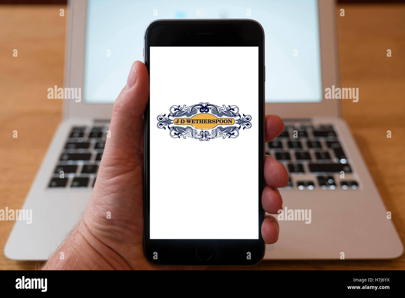Using iPhone smartphone to display logo of JD Wetherspoons pub chain - Stock Image