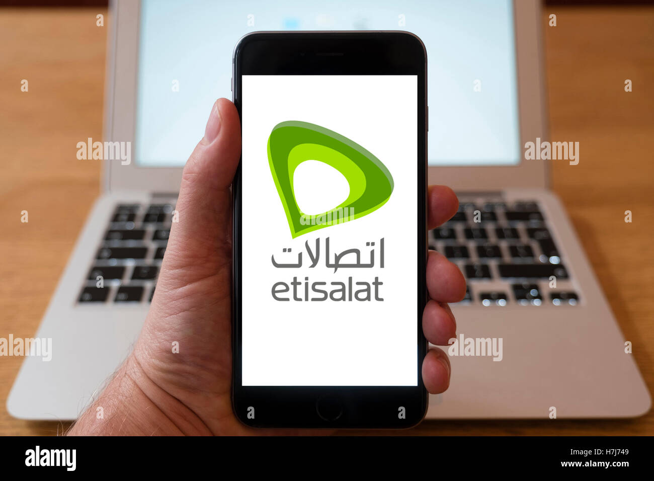 Using iPhone smartphone to display logo of Etisalat the mobile phone