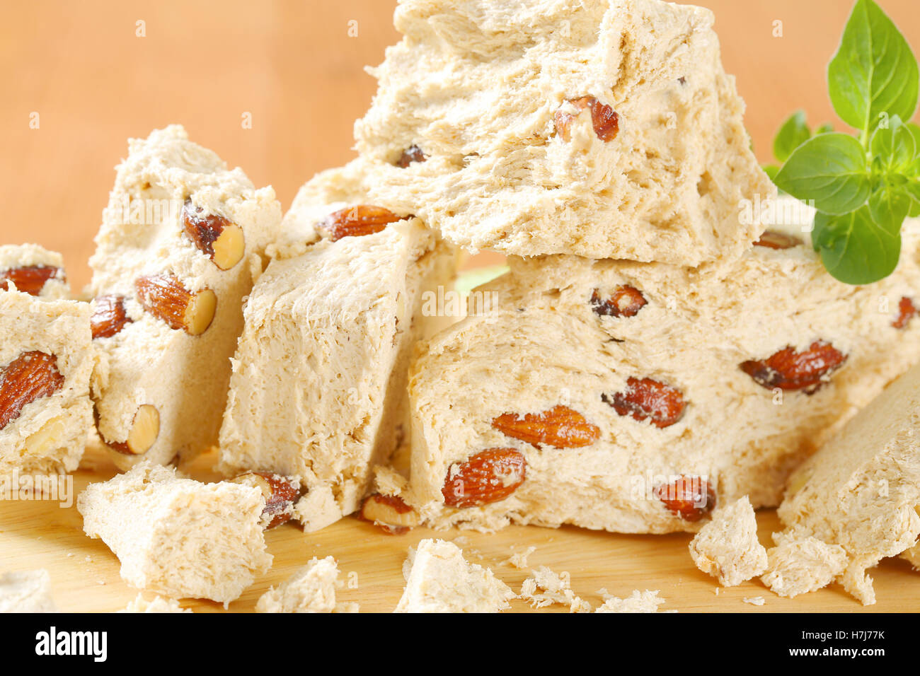 Pieces of Greek halva with almonds - Stock Image