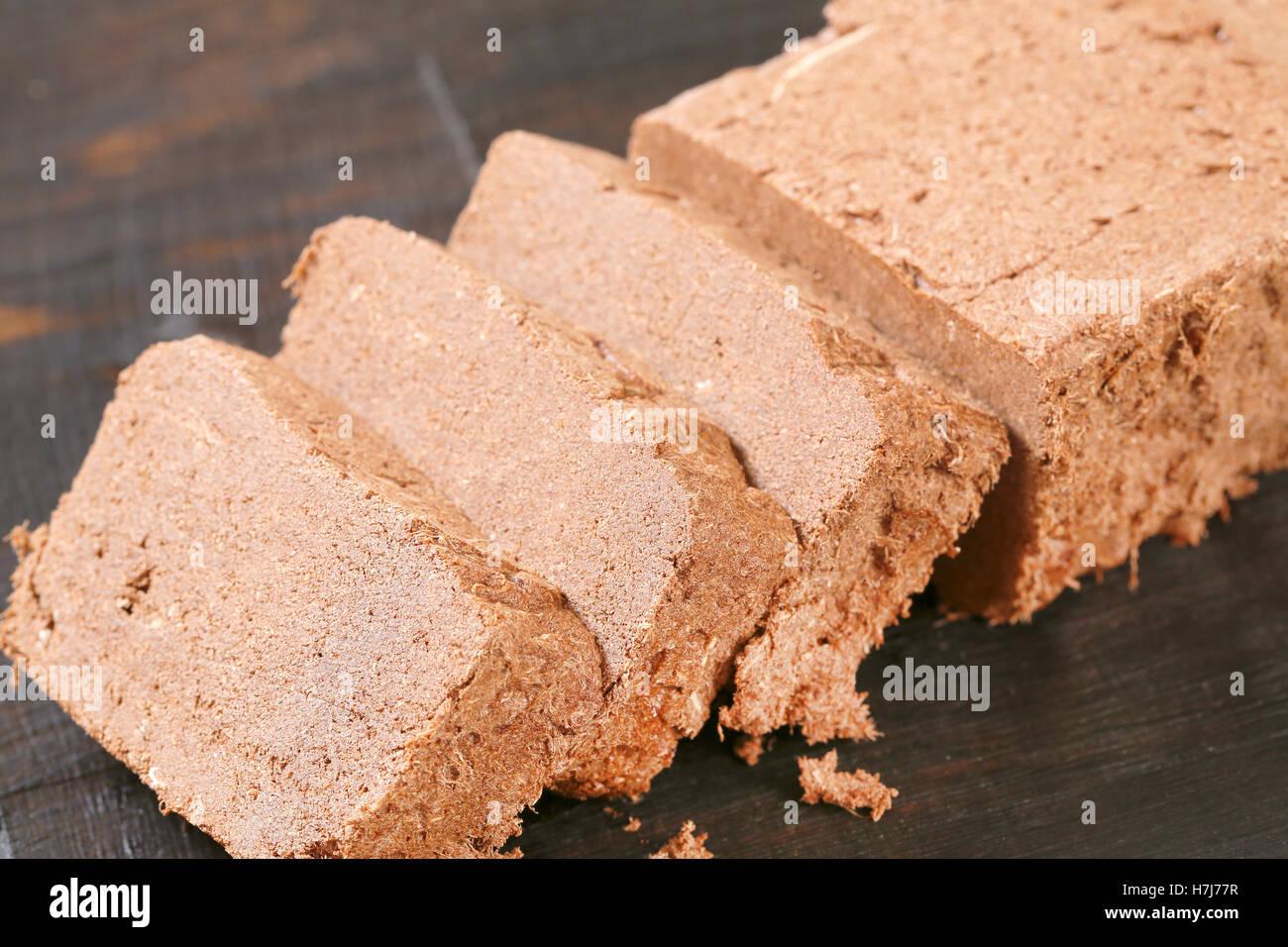 Slices of chocolate halva on cutting board - Stock Image