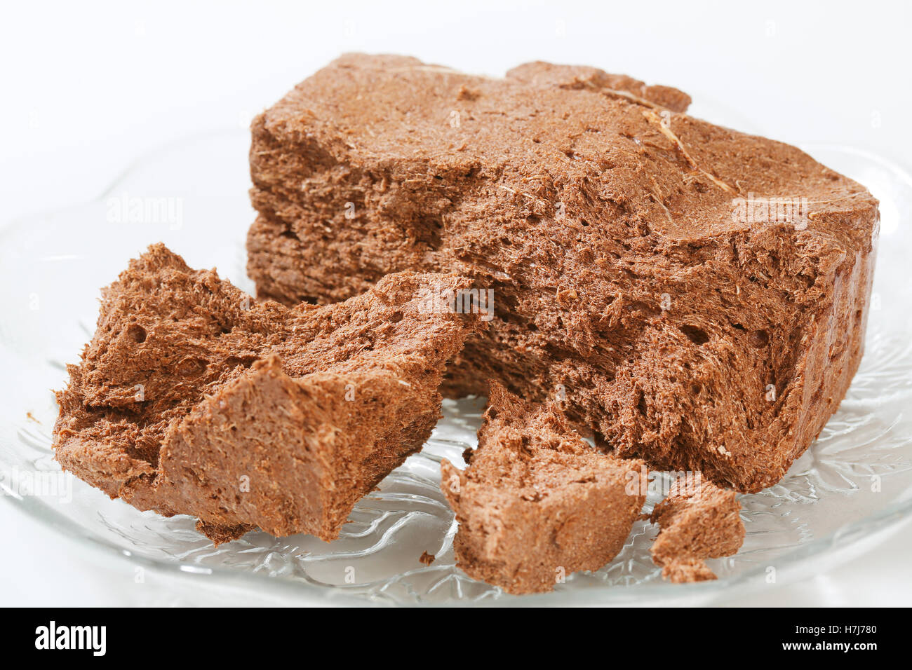 Pieces of chocolate halva on a plate - Stock Image