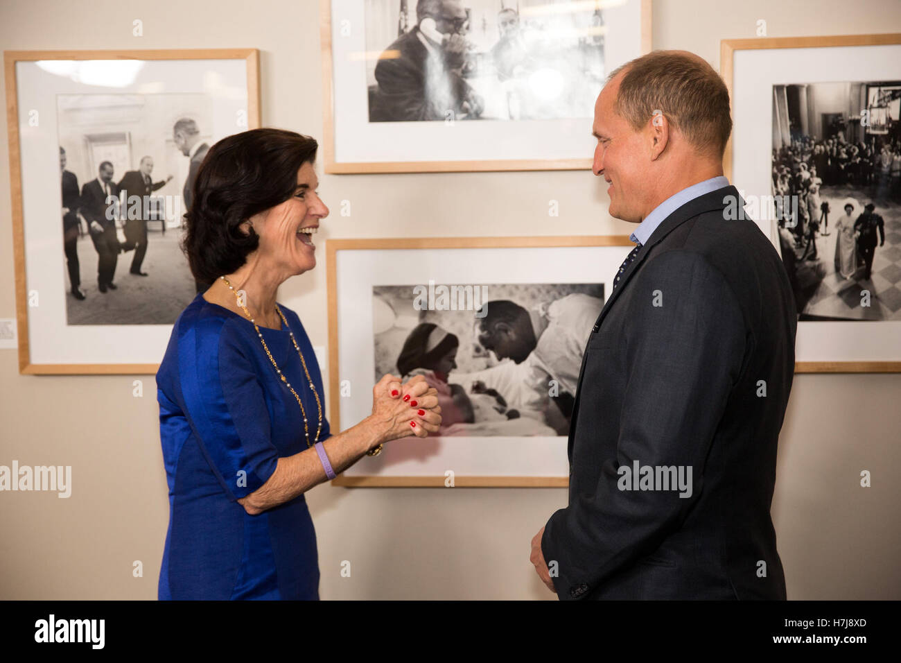 Former U.S. President Lyndon B. Johnsons daughter Luci Baines Johnson speaks with actor Woody Harrelson before a Stock Photo