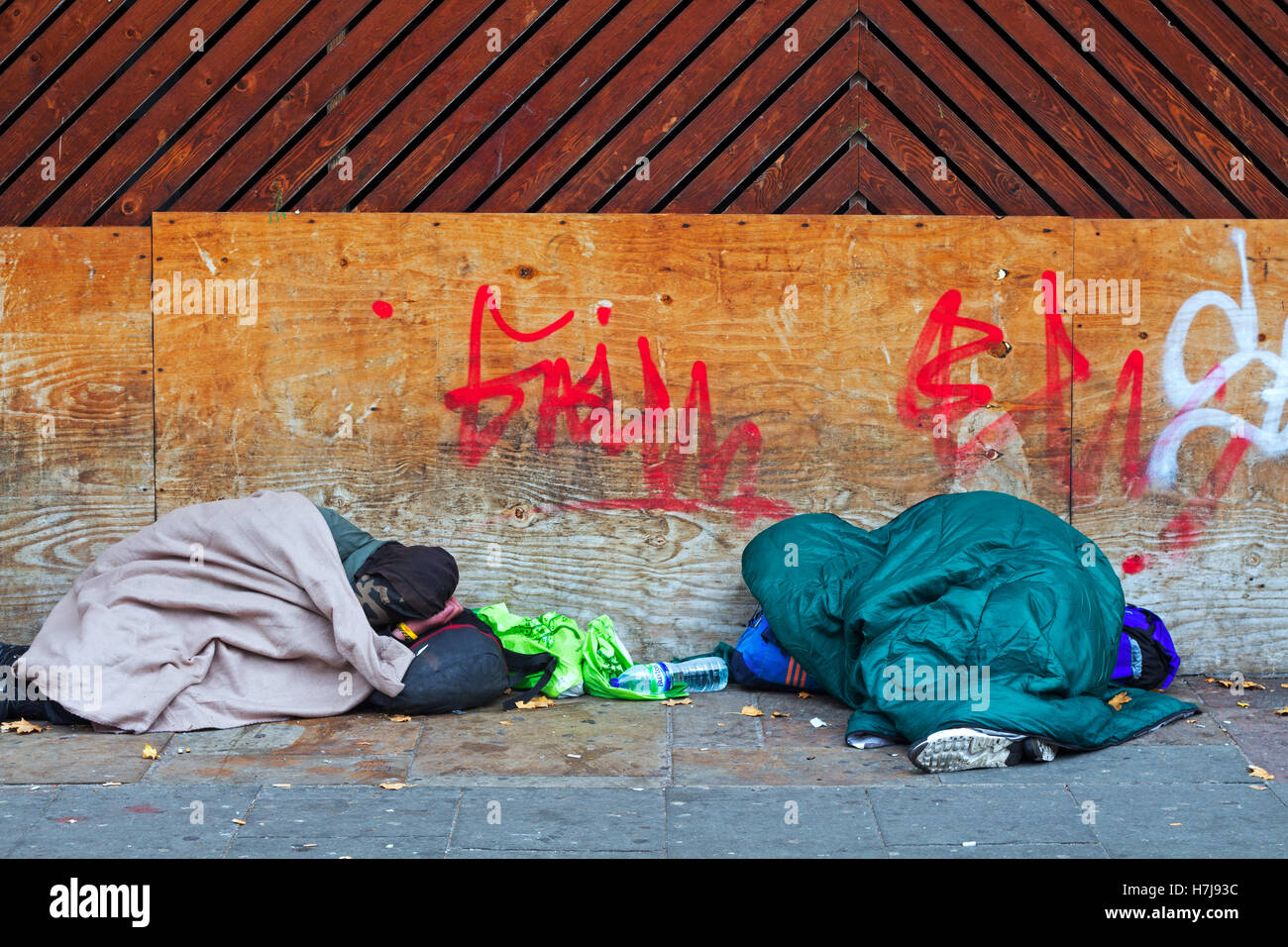 Two homeless people sleeping out on the streets of Liverpool UK - Stock Image