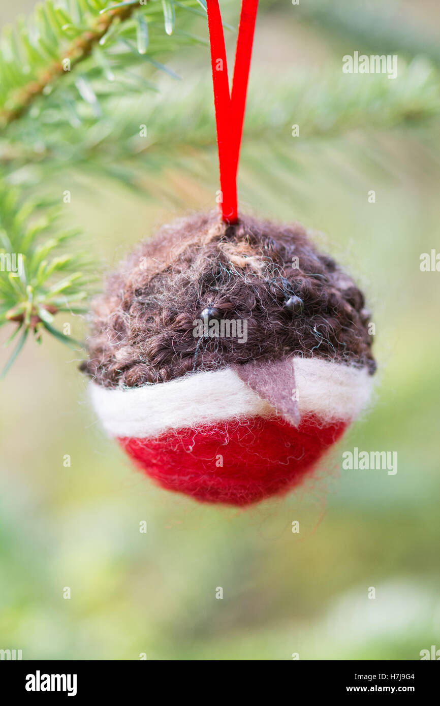 needle felted handmade christmas robin bauble tree decoration - Stock Image