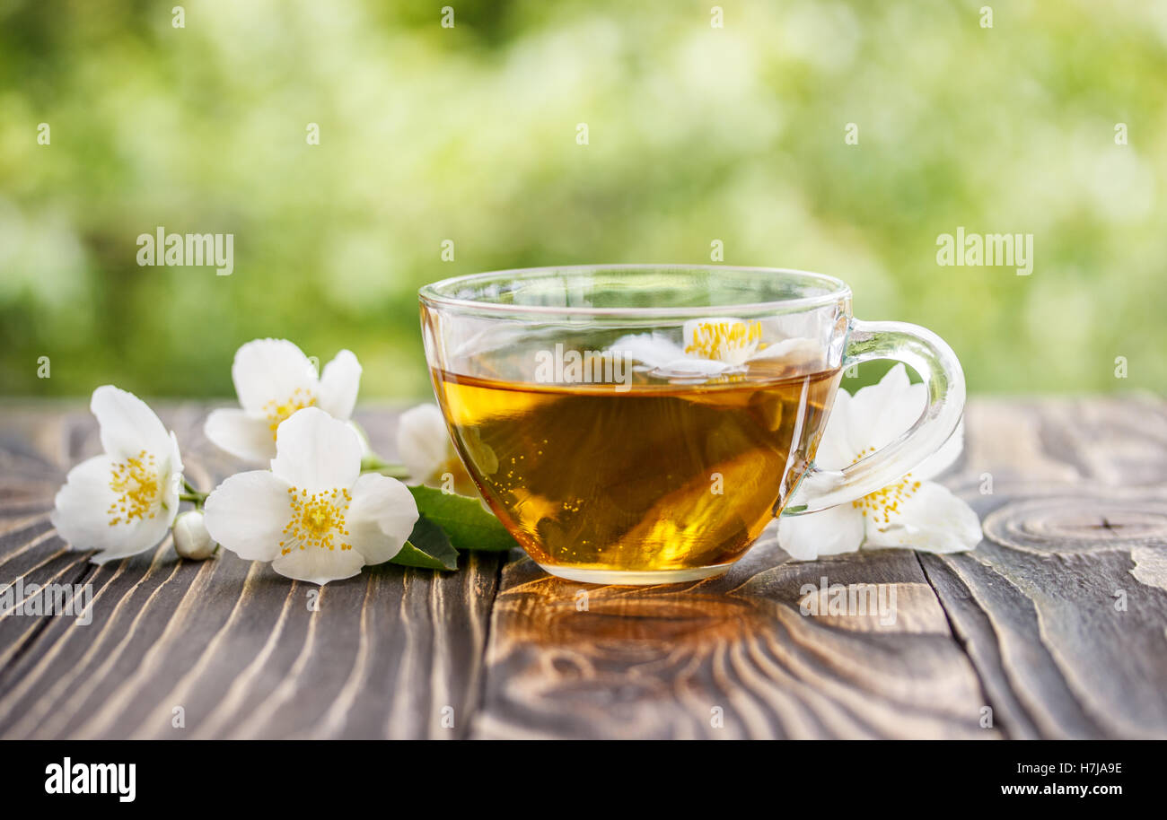 Jasmine Tea And Jasmine Flowers On Wooden Background Stock Photo