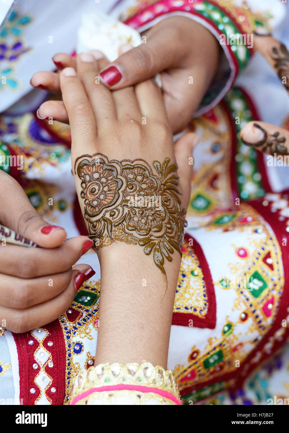 A Young Girl Has A Henna Hand Tattoo Applied As The Prince Of Wales