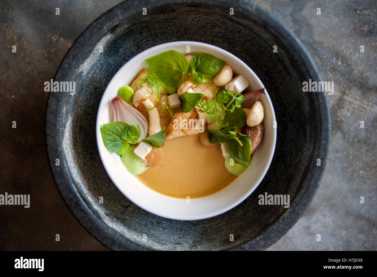 Wild mushroom salad with miso and lemongrass puree and charred shallots at the Common Tiger in Phnom Penh. - Stock Image