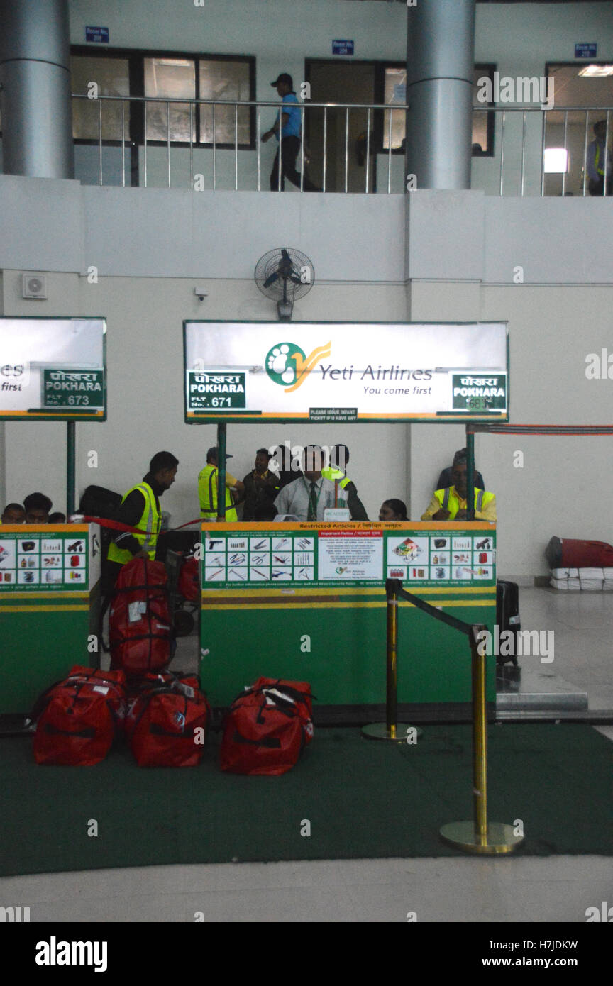 Checking in Desk for Yeti Airlines at the Domestic Terminal at Kathmandu Tribhuvan Airport, Nepal, Asia. - Stock Image