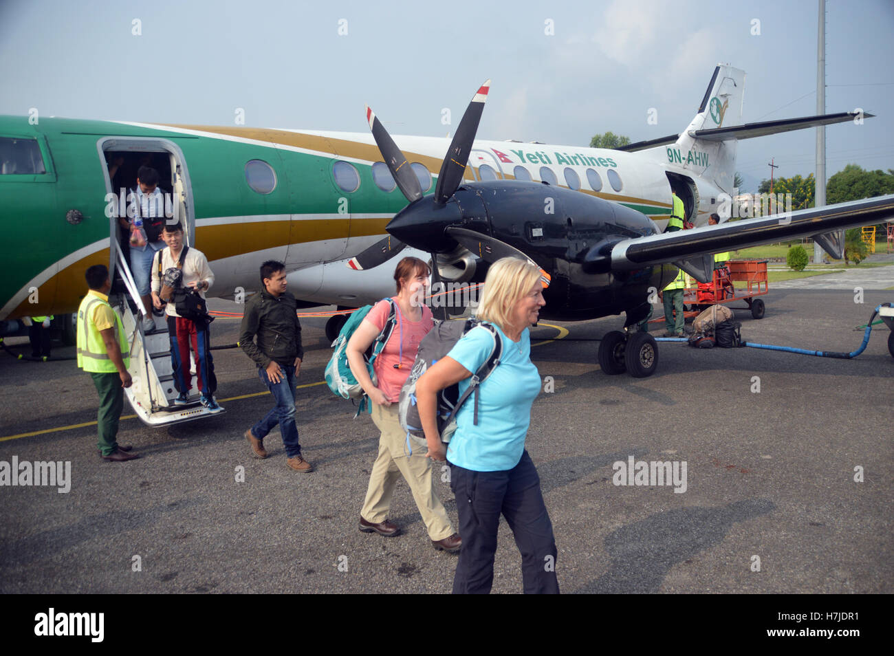 Passengers Arriving on a Jetstream 41Turboprop-powered Plane from a Yeti Airlines Flight from Kathmandu to Pokhara, - Stock Image