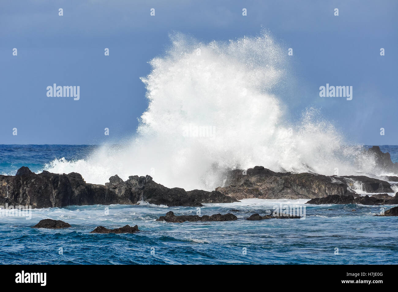 Big waves in the rough coastal landscape in Easter Island, Chile - Stock Image