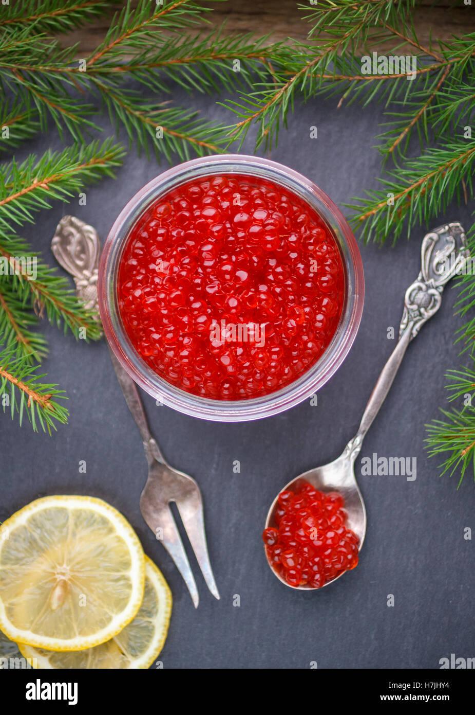 Red salmon caviar and lemon. Selective focus - Stock Image
