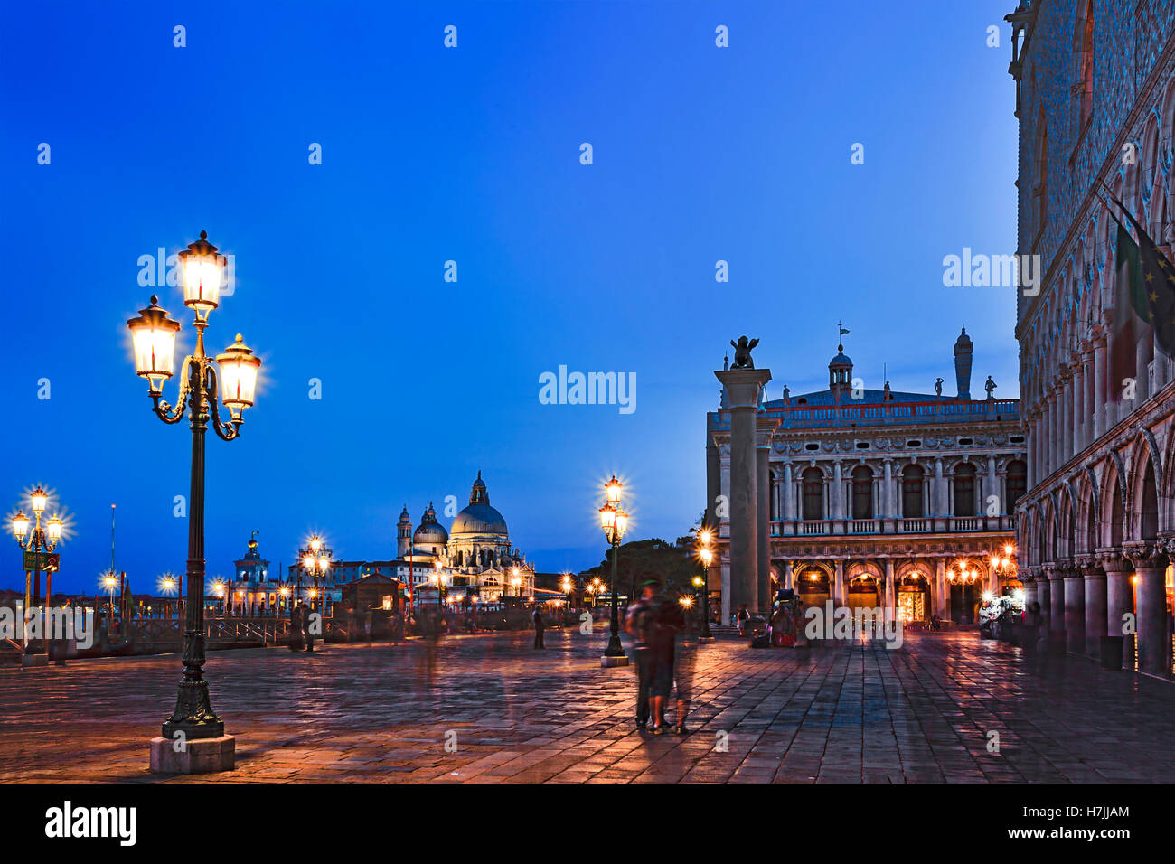 San Marco square along grand canal Gondola pier with Venice republic symbols on erected columns towards Santa Maria - Stock Image