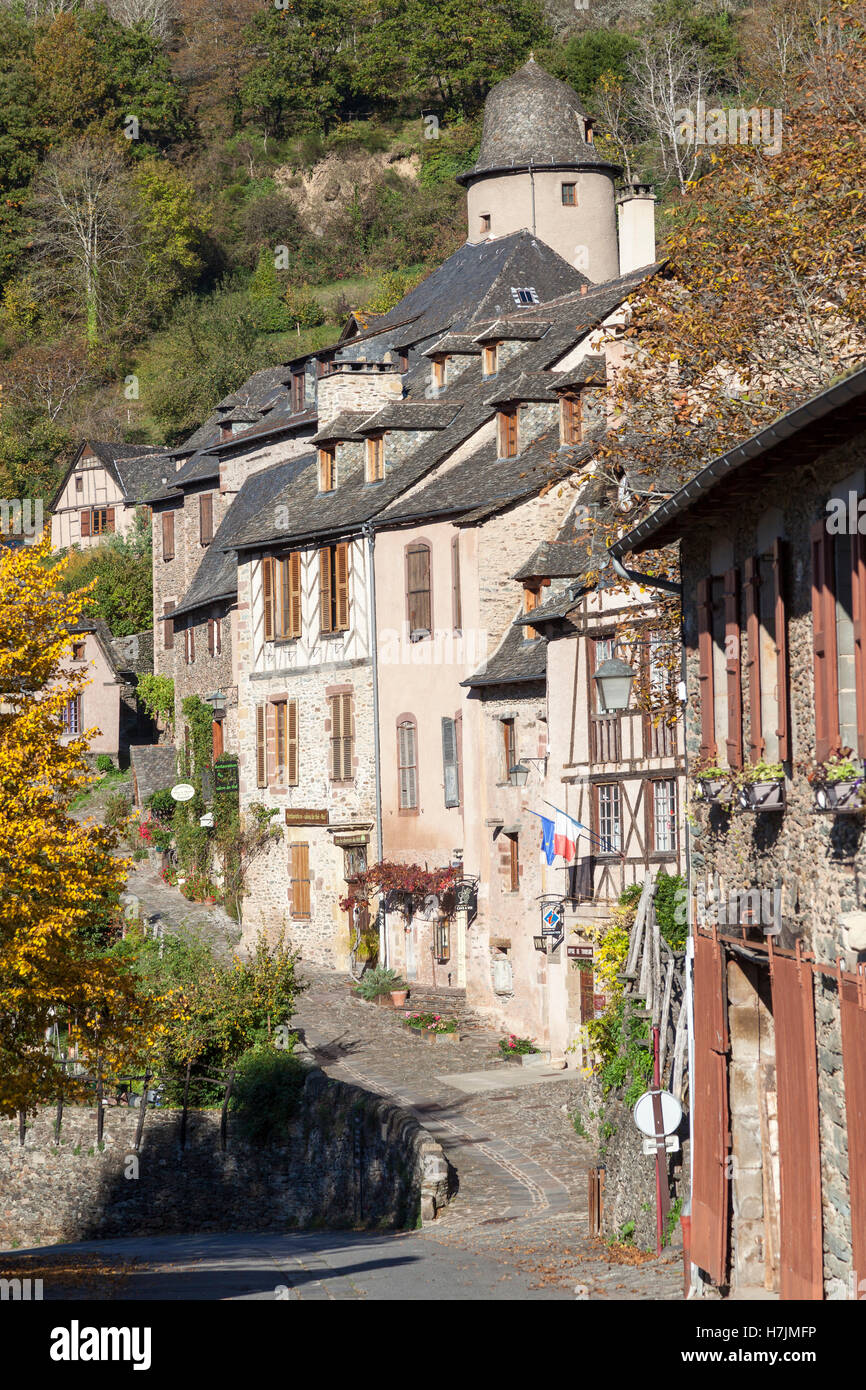 The small medieval village of Conques (France). It shows visitors cobbled streets lined by old houses with their - Stock Image