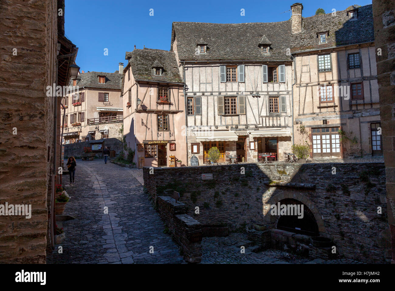 The small medieval village of Conques (Aveyron - France). It shows visitors its cobbled streets lined by half-timbered - Stock Image