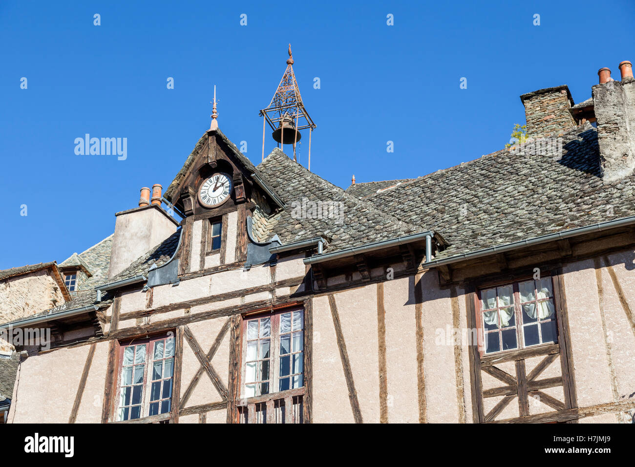 The small medieval village of Conques (Aveyron - France). It shows visitors its old half-timbered houses with their - Stock Image