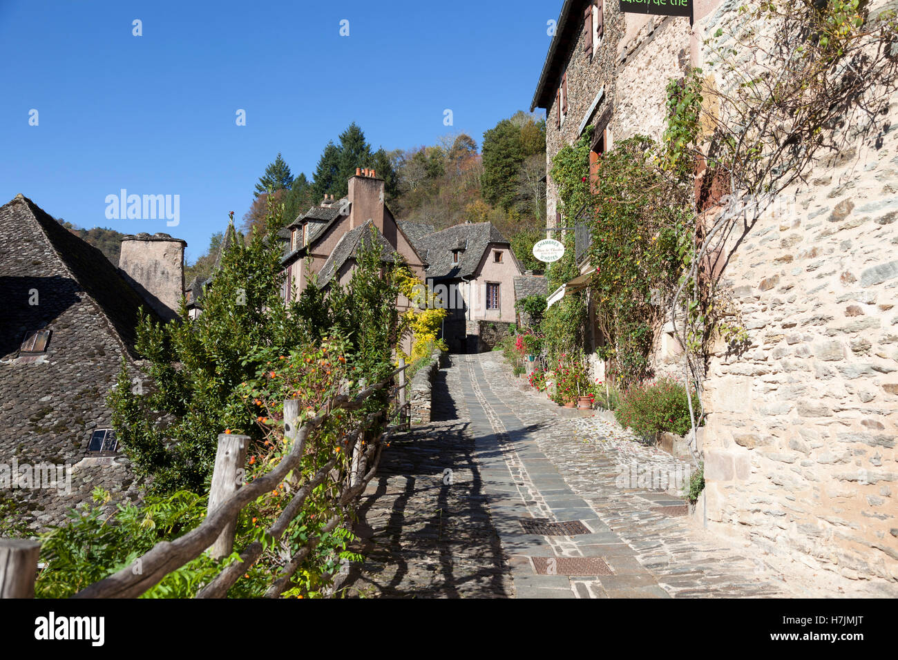 The small medieval village of Conques (Aveyron - France). It shows visitors its cobbled streets lined by old clustered - Stock Image