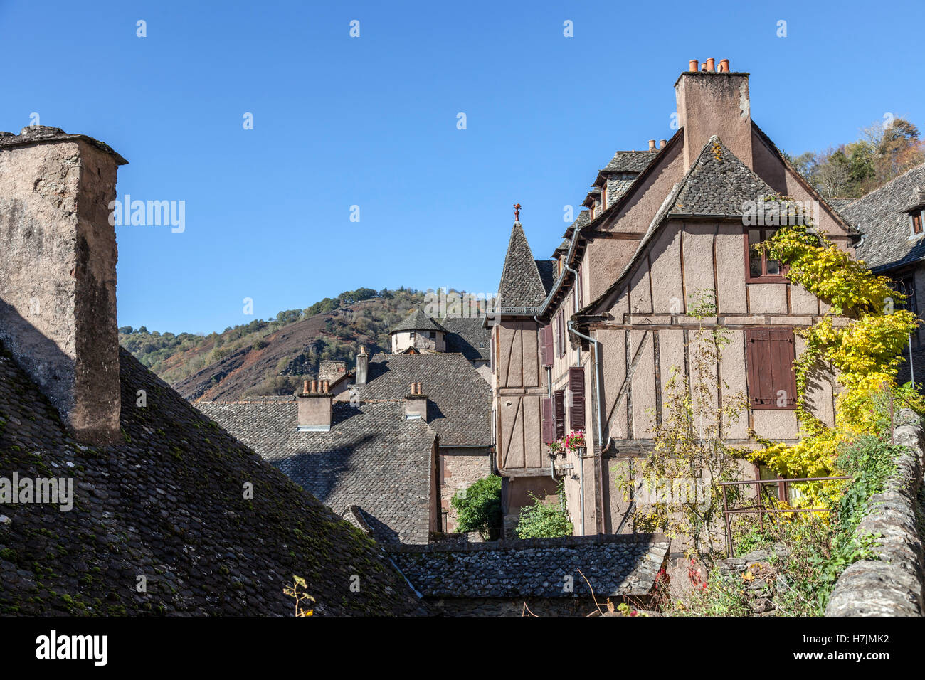 The small medieval village of Conques (Aveyron - France). It shows visitors its old clustered houses topped with - Stock Image