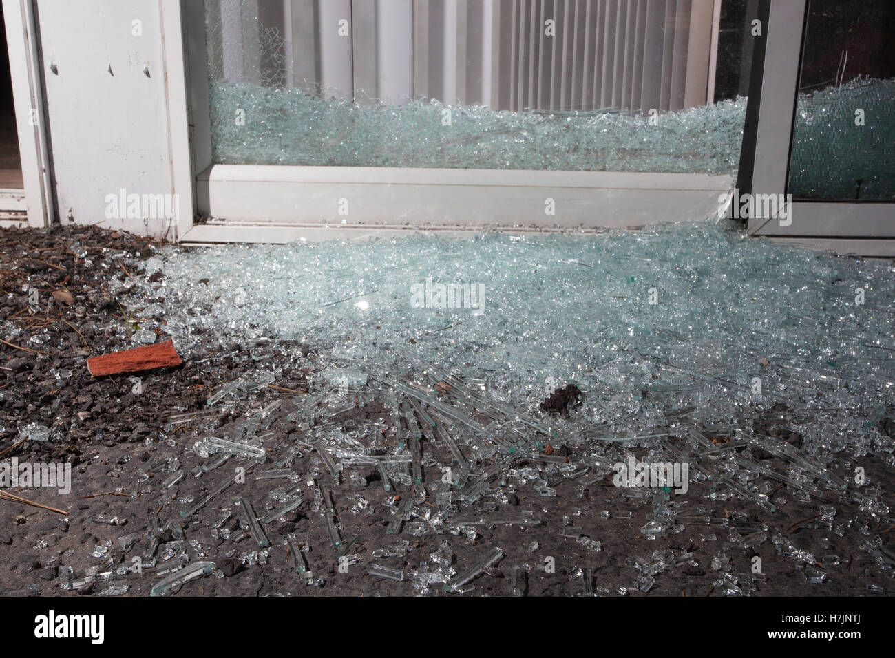 Glass From A Shattered Sliding Door Home Invader Broke