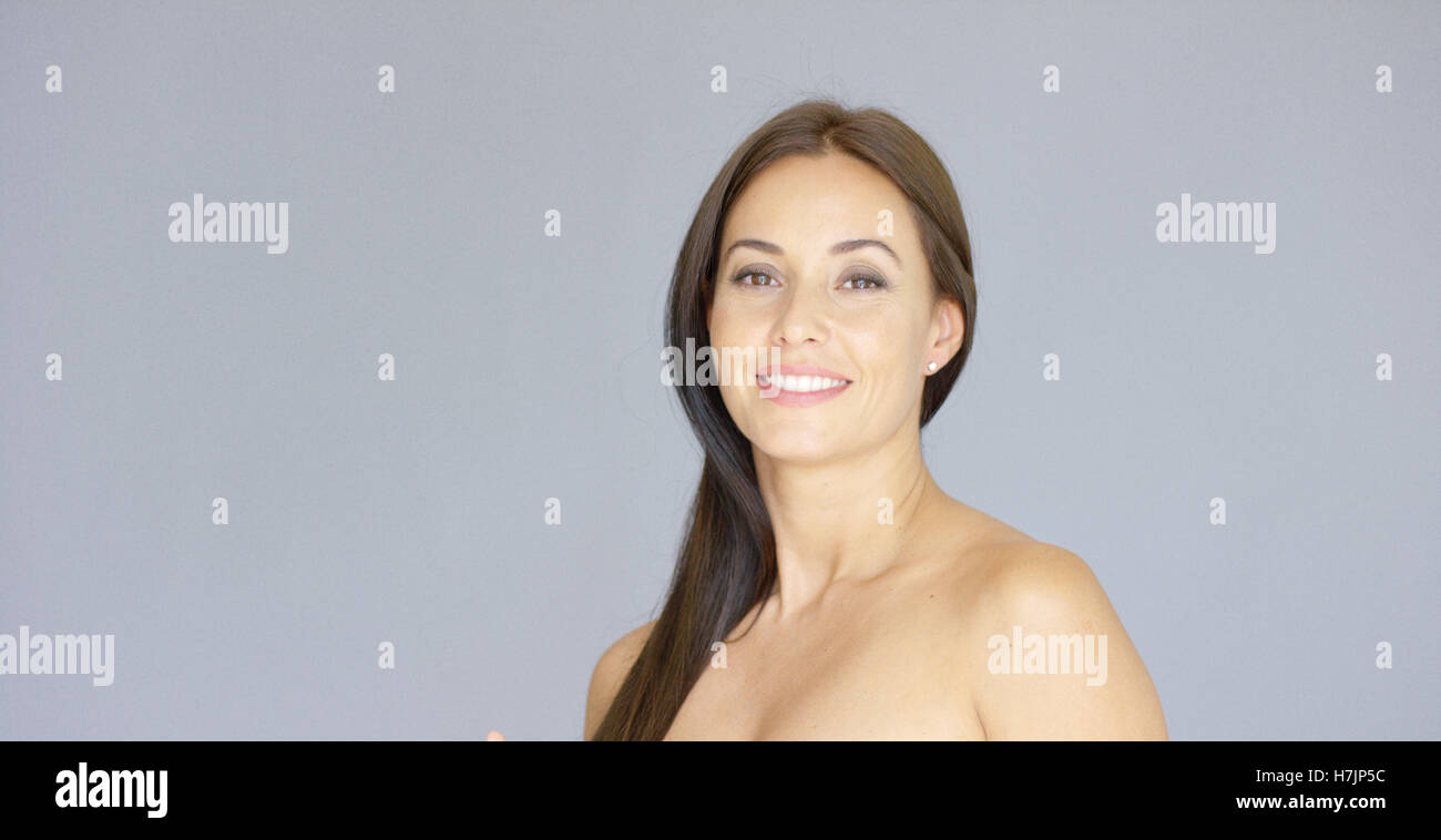 Cute single bare shouldered young adult woman - Stock Image