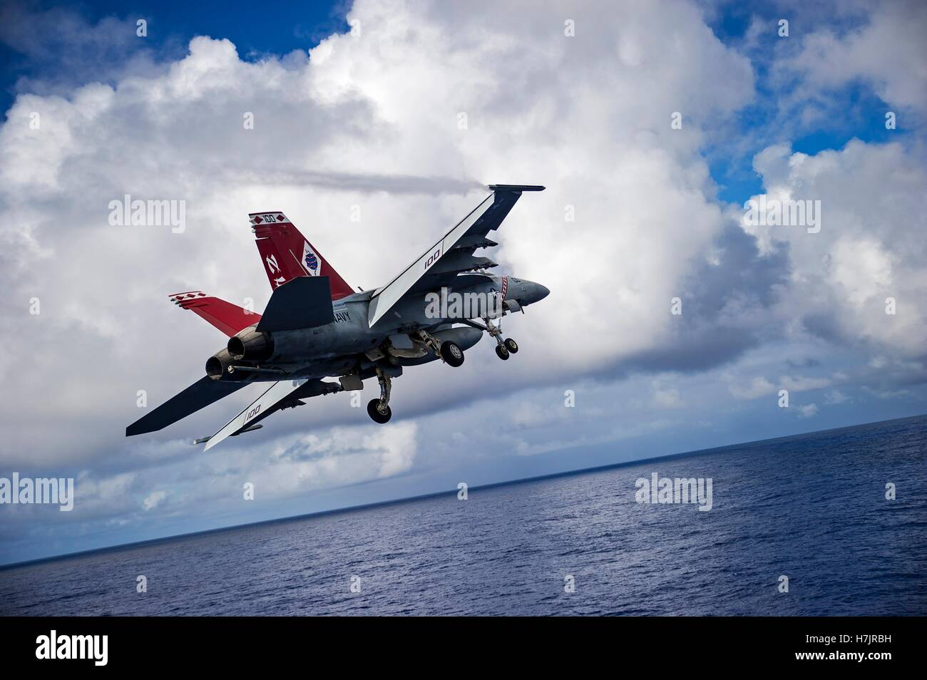 An F/A-18F Super Hornet fighter aircraft launches from the flight deck of the USN Nimitz-class aircraft carrier - Stock Image