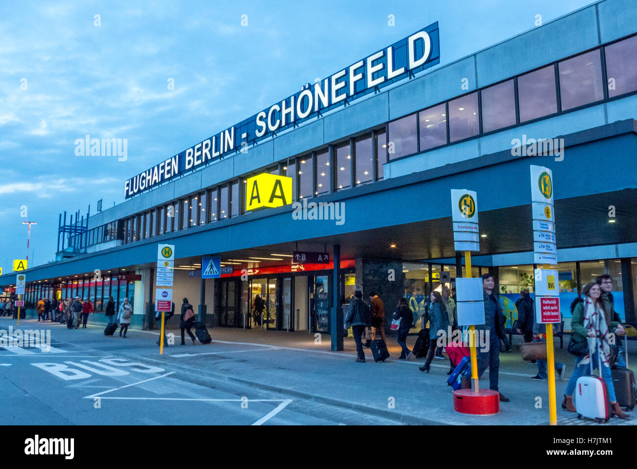 The main building at Berlin's Schoenefeld Airport at dusk - Stock Image